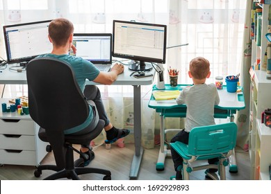 Father with kid trying to work from home during quarantine. Stay at home, work from home concept during coronavirus pandemic