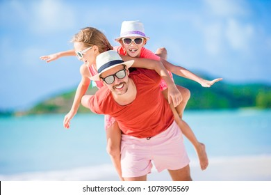 Father and kids enjoying beach summer tropical vacation. Family having fun on beach vacation