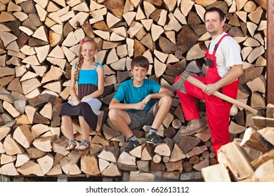 Father and kids taking a break from chopping and stacking firewood into a wood shed
