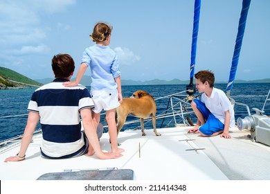 Father, kids and their pet dog sailing on a luxury yacht or catamaran boat