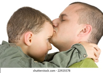 father kissing his son, isolated on white