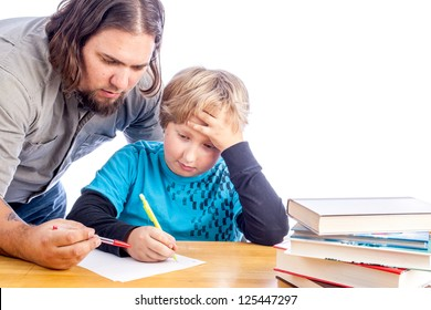 father leaning over to help son work one home work. Sitting at a desk with papers and books isolated on white with space for custom text