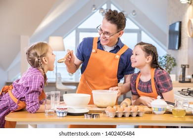 Father with little  children have cooking together in the kitchen at home