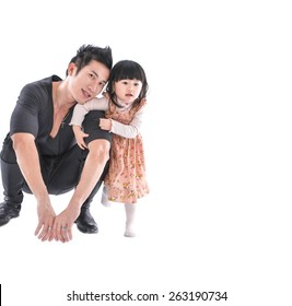 Father and little daughter smiling on white background