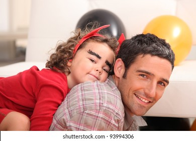 father and little girl celebrating Halloween