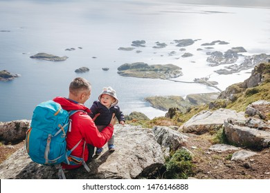 father and little son travel in mountains. Family, travel, vacation, childhood, father's day concept. Norway. Lofotens