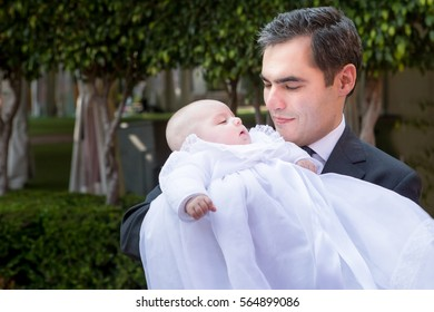 Father looking at adorable baby.