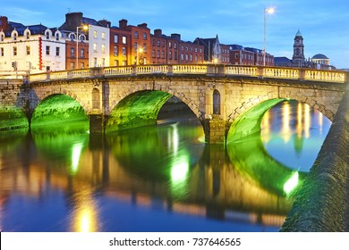 The Father Matthew Bridge in Dublin spanning the River Liffey illuminated at night