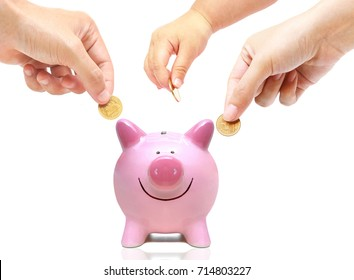 Father, mother, and baby in the family do saving money in pink piggy bank