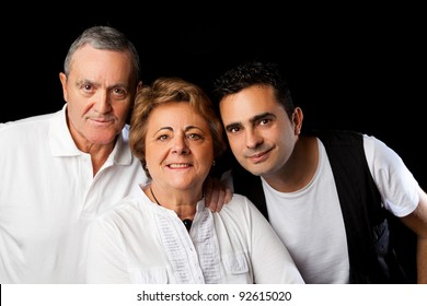 Father, mother and son isolated on black background