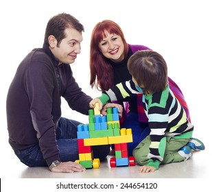 Father, mother and son playing lego over white background