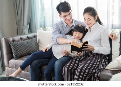 Father and mother Teaching children to do their homework at home,Asian family is happy