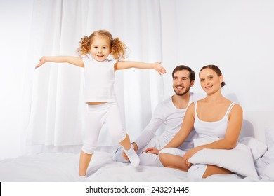 Father, mother and their cute daughter playing