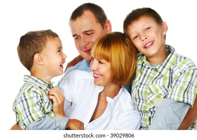 father, mother and their two sons laughing