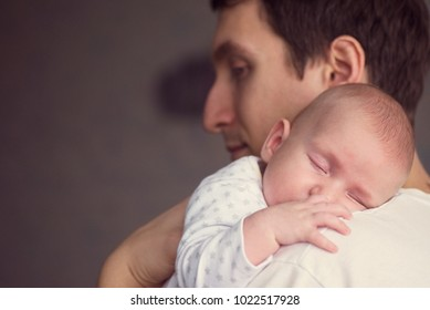 Father with newborn child. Parent holding cute baby, infant. Young dad taking care of  small kid. Happy childhood. Little son, man, male. Beautiful boy. Family happiness.