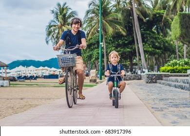Father on a bike and son on a balancebike.