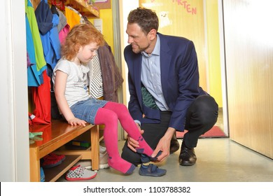A father picks up his child in nursery