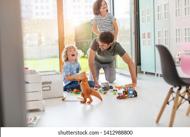 Father playing with his children at home