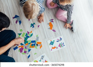 Father playing puzzle with children