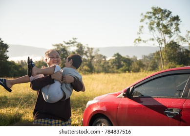 Father playing with son on traveling with car  family trip