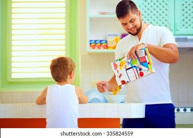 father preparing cornflakes for son in the morning, breakfast at home