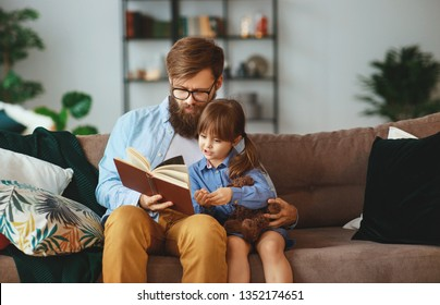 father reading a book to a child daughter at home     father, child, book, family, daughter,