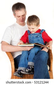 Father reading book her son