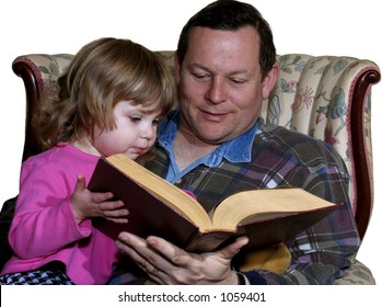 Father reading a story to toddler daughter isolated on white
