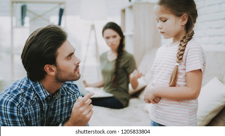 Father Scolds Daughter. Family Problems. Scared Child. Complicated Relationship. Family Quarrel. Bad Parents. Sufferings Children. Man Screams Girl. Woman Arguing with Man. Woman Working on Laptop.