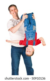 Father shaking his son upside-down on white background
