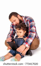 father shows his little son how to use the tablet, the front view