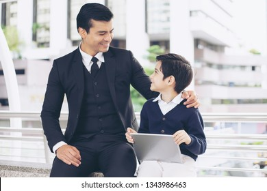 Father single dad playing game smart phone together on business district urban, Dad and Son happy family concept