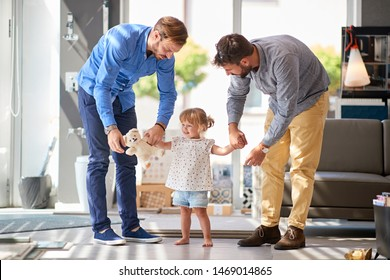father with smiling child in store for household