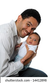 Father smiling and holding baby boy isolated over a white background