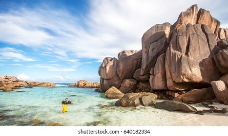 Father and son in Anse Coco beach, La Digue, Seychelles