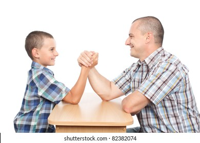 Father and son arm wrestling for fun, isolated on white background