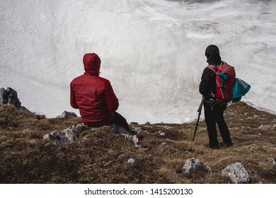 Father and son, backpackers, hiking in the Austrian Alps . High snow Wall around