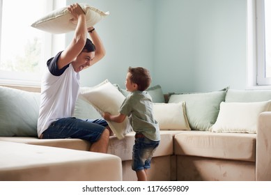 A Father and son in bed, happy time on bed.