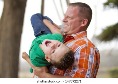 Father and son being playful outdoors together.