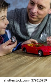 father and son building a model car together