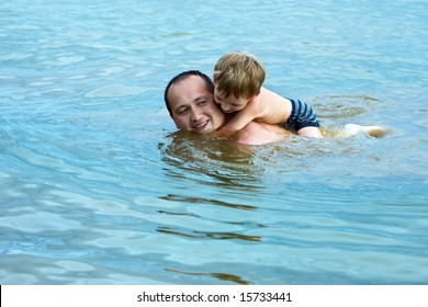 Father and the son cheerfully bathe