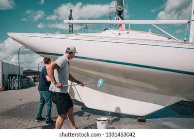 Father and son cleaning a boat