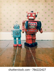 Father and son concept with retro robot toys on an old wooden floor with reflection
