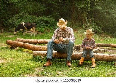 a  father and son of a cowboy