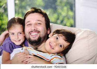 Father son and daughter at home