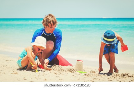 father with son and daughter play on beach