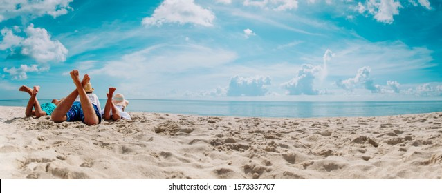 father with son and daughter relax on beach vacation, panorama