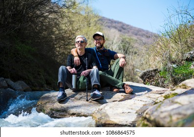 Father and son enjoying nature by the river