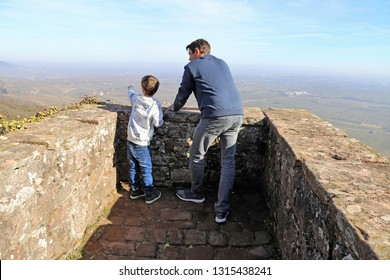 Father and son enjoying the view from the Madenburg, Rhineland-Palatinate, Germany