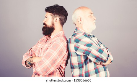 father and son family. generational conflict. barbershop and hairdresser salon. male beard care. checkered fashion. youth vs old age compare. retirement. two bearded men senior mature. relationship.